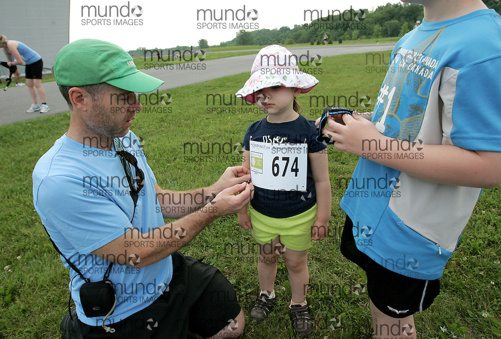 (Ottawa, Canada---19 June 2010) A tyke is prepared for the 1km kid's run at the 2010 edition of Emilie's Run - The Emilie Mondor Memorial 5K Race for Women. Photograph copyright Sean Burges / Mundo Sport Images, 2010.