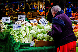 Buying vegetables from a stall in the Bullring Market in Birmingham, England, UK<br /> <br /> (c) Andrew Wilson | Edinburgh Elite media