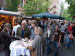 Popular weekend market at Kollwitzplatz in bohemian Prenzlauer Berg in Berlin Germany
