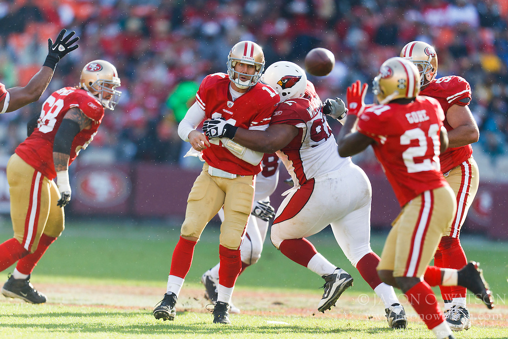 Nov 20, 2011; San Francisco, CA, USA; San Francisco 49ers quarterback Alex Smith (11) is hit by Arizona Cardinals nose tackle Dan Williams (92) while throwing a pass during the third quarter at Candlestick Park. San Francisco defeated Arizona 23-7. Mandatory Credit: Jason O. Watson-US PRESSWIRE