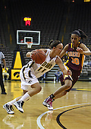 February 18, 2010: Iowa center Trisha Nesbitt (11) tries to drive around Minnesota guard Kiara Buford (30) during the first half of the NCAA women's basketball game at Carver-Hawkeye Arena in Iowa City, Iowa on February 18, 2010. Iowa defeated Minnesota 75-54.