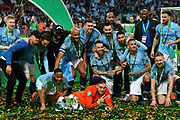 Manchester City celebrate with the Carabao Cup after winning the final on penalties during the Carabao Cup Final match between Chelsea and Manchester City at Wembley Stadium, London, England on 24 February 2019.