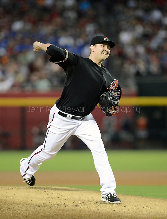 PHOENIX, AZ - JUNE 08:  Starting pitcher Trevor Cahill #35 of the Arizona Diamondbacks pitches against the San Francisco Giants in the first inning at Chase Field on June 8, 2013 in Phoenix, Arizona. The Giants defeated the Diamondbacks 10-5.  (Photo by Jennifer Stewart/Getty Images) *** Local Caption *** Trevor Cahill