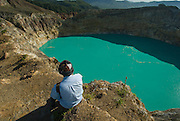 Trekker Chris Neal enjoys a ringside seat at Kelimutu Lakes, Flores.
