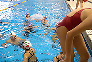 Members of the Mexican swim team team play and warm-up prior to a race at the International Children`s Games.