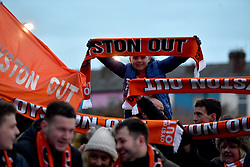 """Blackpool fans outside the stadium hold up Oyston Out scarves in protest prior to the beginning of the Emirates FA Cup, third round match at Bloomfield Road, Blackpool. PRESS ASSOCIATION Photo. Picture date: Saturday January 5, 2019. See PA story SOCCER Blackpool. Photo credit should read: Anthony Devlin/PA Wire. RESTRICTIONS: EDITORIAL USE ONLY No use with unauthorised audio, video, data, fixture lists, club/league logos or """"live"""" services. Online in-match use limited to 120 images, no video emulation. No use in betting, games or single club/league/player publications."""