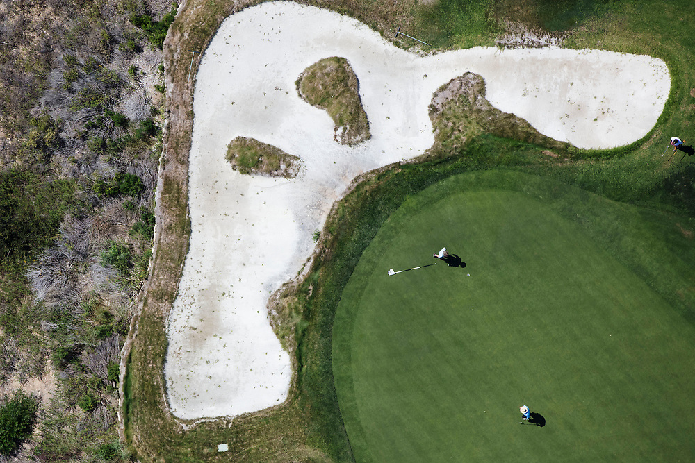People golf at the Trump National Golf Club, Los Angeles  in this aerial photograph taken during the historic drought over Rancho Palos Verdes, California, U.S., on Monday, August 31, 2015. Owned by The Trump Organization, the course was formerly known as Ocean Trails Golf Club, an 18-hole course designed by Pete Dye, which was about to open when a landslide occurred. Donald Trump bought the property known for it's views of the Pacific Ocean in 2002. © 2015 Patrick T. Fallon
