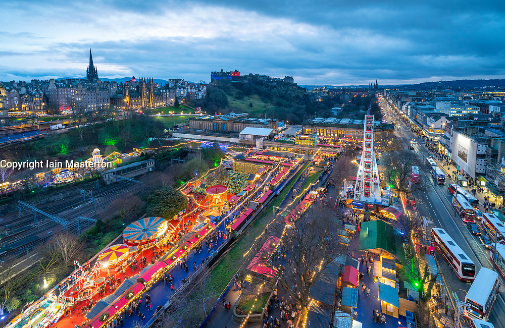 View of Edinburgh Christmas Market in west Princes Street gardens and skyline of the city towards the castle in Edinburgh, Scotland, UK