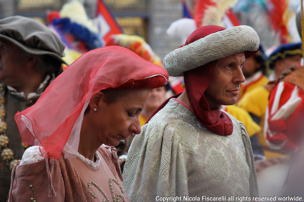 The Florentine reenactors are dressed in renaissance attire in a shove of beautiful pageantry during a city celebration.