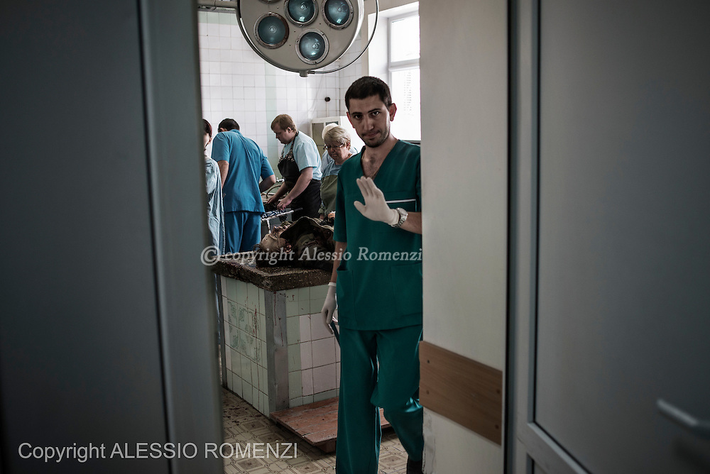 Ukraine, Donetsk: A doctor prevents journalists to enter a city morgue in Donetsk as bodies of pro-Russian gunmen killed in clashes with Ukrainian government forces around the airport are examined on May 26, 2014. ALESSIO ROMENZI