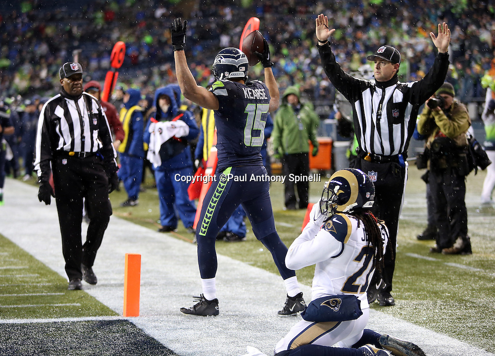 St. Louis Rams cornerback Janoris Jenkins (21) looks on while kneeling on the ground while Seattle Seahawks wide receiver Jermaine Kearse (15) raises his arms signaling touchdown after Kearse catches an 18 yard touchdown pass with 17 seconds left in the fourth quarter, cutting the Rams lead to 23-17, during the 2015 NFL week 16 regular season football game against the St. Louis Rams on Sunday, Dec. 27, 2015 in Seattle. The Rams won the game 23-17. (©Paul Anthony Spinelli)