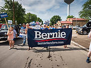 04 JULY 2019 - SLATER, IOWA: Supporters of Senator Bernie Sanders (Ind-VT) march in the 4th of July parade in Slater, IA, to start. Sen. Sanders marched in the 4th of July parade in Slater to support his bid to be the Democratic nominee for the US presidency in 2020. Iowa holds the first presidential selection event of the 2020 election cycle. The Iowa caucuses are on Feb. 3, 2020.          PHOTO BY JACK KURTZ
