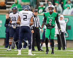 Oct 3, 2015; Huntington, WV, USA; Marshall Thundering Herd wide receiver Davonte Allen jaws with Old Dominion Monarchs safety Justice Davila during the second quarter at Joan C. Edwards Stadium. Mandatory Credit: Ben Queen-USA TODAY Sports