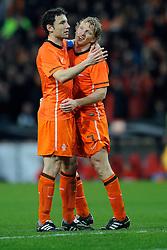 09-02-2011 VOETBAL: NEDERLAND - OOSTENRIJK: EINDHOVEN<br /> Netherlands in a friendly match with Austria won 3-1 / Dirk Kuijt and captain Mark van Bommel after the 3-0 score from eleven meters <br /> ©2011-WWW.FOTOHOOGENDOORN.NL
