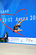 Alevrogianni Korina during qualifying at ribbon in Pesaro World Cup 11 April 2015. Korina  was born on 5 June,1997 in Athens. She is a Greek individual rhythmic gymnast.