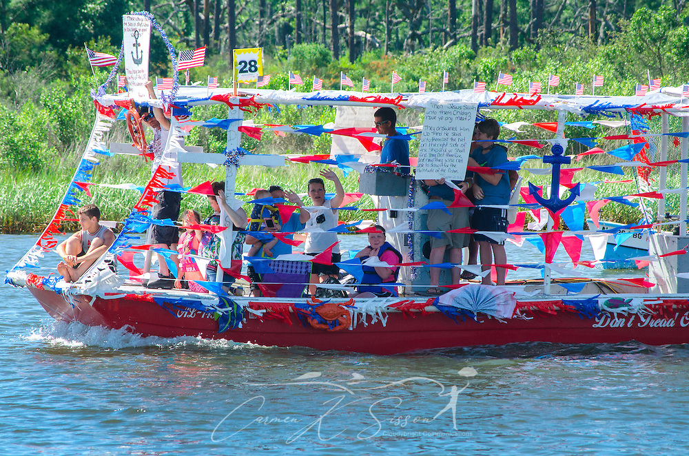 """A decorated shrimp boat, """"Don't Tread on Me,""""  travels down the bayou during the 66th annual Blessing of the Fleet in Bayou La Batre, Alabama, May 3, 2015. The first fleet blessing was held by St. Margaret's Catholic Church in 1949, carrying on a long European tradition of asking God's favor for a bountiful seafood harvest and protection from the perils of the sea. The highlight of the event is a blessing of the boats by the local Catholic archbishop and the tossing of a ceremonial wreath in memory of those who have lost their lives at sea. The event also includes a land parade and a parade of decorated boats that slowly cruise through the bayou. (Photo by Carmen K. Sisson/Cloudybright)"""