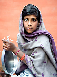 Young girl making music for dancing, Spring festival in Jaipur, India. Photo taken while traveling in Rajasthan, India, with Steve McCurry.