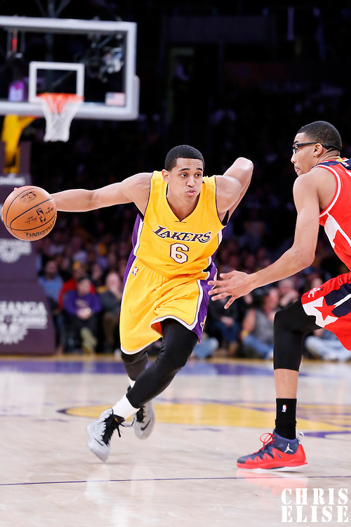 27 January 2015: Los Angeles Lakers guard Jordan Clarkson (6) drives past Washington Wizards forward Otto Porter Jr. (22) during the Washington Wizards 98-92 victory over the Los Angeles Lakers, at the Staples Center, Los Angeles, California, USA.