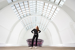© Licensed to London News Pictures. 12/10/2017. Leeds UK. Phoebe Moore stands in the Central Court of Leeds Art Gallery which was has been opened up to the public after being hidden away behind false ceiling's for 60 years. The Art Gallery is to reopen tomorrow (friday 13th Oct) after an 18month renovation costing £4.5M  with new acquisitions & rehanging of the extensive collection. Founded in 1888, Leeds Art Gallery has designated collection of 19th & 20th century British painting & sculpture widely considered to be the best outside the national collections. Photo credit: Andrew McCaren/LNP