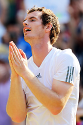 Andy Murray  celebrates  after winning  the Men's Final at the Wimbledon Tennis Championships in  London, Sunday, 7th July 2013<br /> Picture by Stephen Lock / i-Images