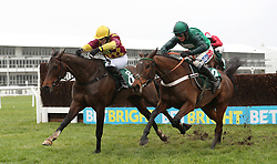 Eventual winner Siruh Du Lac ridden by Lizzie Kelly (left) jumps the last with Janika ridden by Daryl Jacob in the Spectra Cyber Security Solutions Trophy Handicap Chase during Festival Trials Day at Cheltenham Racecourse.