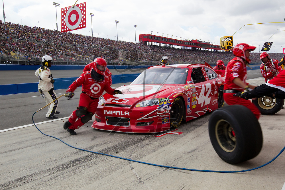 FONTANA, CA - MAR 27, 2011:  Juan Pablo Montoya (42) comes in for a pit stop during the Auto Club 400 race at the Auto Club Speedway in Fontana, CA.