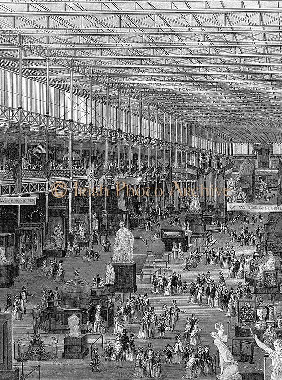 Great Exhibition of 1851, Crystal Palace, Hyde Park, London.  Interior view of main avenue looking east, showing galleries supported by iron columns rising to ridge-and-furrow glass roof. Steel engraving  1851.