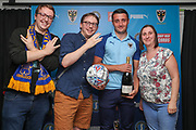AFC Wimbledon midfielder Anthony Hartigan (8) receiving man of match award during the EFL Sky Bet League 1 match between AFC Wimbledon and Shrewsbury Town at the Cherry Red Records Stadium, Kingston, England on 14 September 2019.