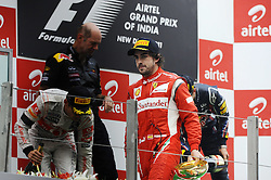 30.10.2011, Jaypee-Circuit, Noida, IND, F1, Grosser Preis von Indien, Noida, im Bild Podium - Jenson Button (GBR),  McLaren F1 Team  - Adrian Newey (GBR), Red Bull Racing (ex. McLaren), Technical Operations Director - Fernando Alonso (ESP),  Scuderia Ferrari // during the Formula One Championships 2011 Large price of India held at the Jaypee-Circui 2011-10-30. EXPA Pictures © 2011, PhotoCredit: EXPA/ nph/ Dieter Mathis +++++ ATTENTION - OUT OF GERMANY/(GER), CROATIA/(CRO), BELGIAN/(BEL) +++++