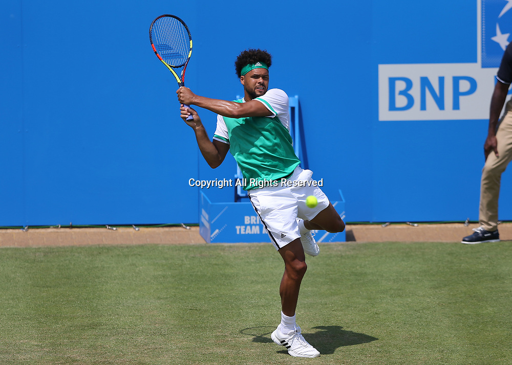 June 21st 2017, Queens Club, West Kensington, London; Aegon Tennis Championships, Day 3; Jo-Wilfried Tsonga of France with a backhand versus Gilles Muller of Luxembourg