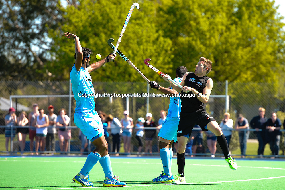 James COUGHLAN of the Black Sticks , Rupinder Pal Singh and RV Ramachandra of India go for a high ball during the Mens Hockey International, 2015 South Island Tour game between the New Zealand Black Sticks V India, at Marist Park, Christchurch, on the 11th October 2015. Copyright Photo: John Davidson / www.photosport.nz