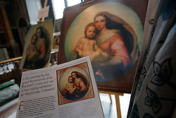 UK ENGLAND LONDON 5MAY12 - Contextual leaflet explaining the story of the De Brecy Tondo artwork, suspected to be by Reniassance painter Rafael is on display at the Westminster Cathedral in central London.....The Tondo displays striking resemblance to Rafael's Sistine Madonna, finished as a commissioned altarpiece and the last painting he completed with his own hands a few years before his death...Relocated to Dresden from 1754, the well-known painting has been particularly influential in Germany...jre/Photo by Jiri Rezac....© Jiri Rezac 2012