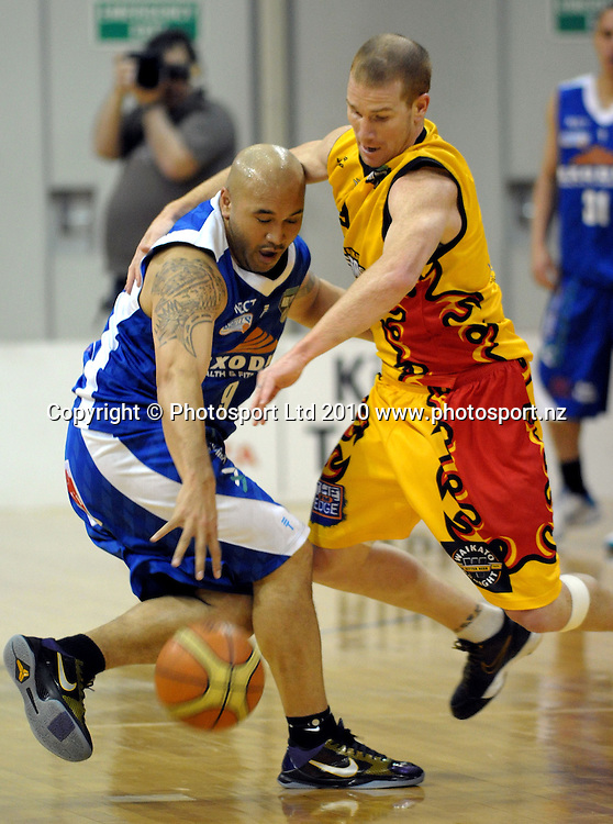 Pistons guard Hayden Allen tries to get the ball off George Le'afa. NBL finals game two - Wellington Saints v Waikato Pistons at TSB Bank Arena, Wellington on Wednesday, 30 June 2010. Photo: Dave Lintott/PHOTOSPORT