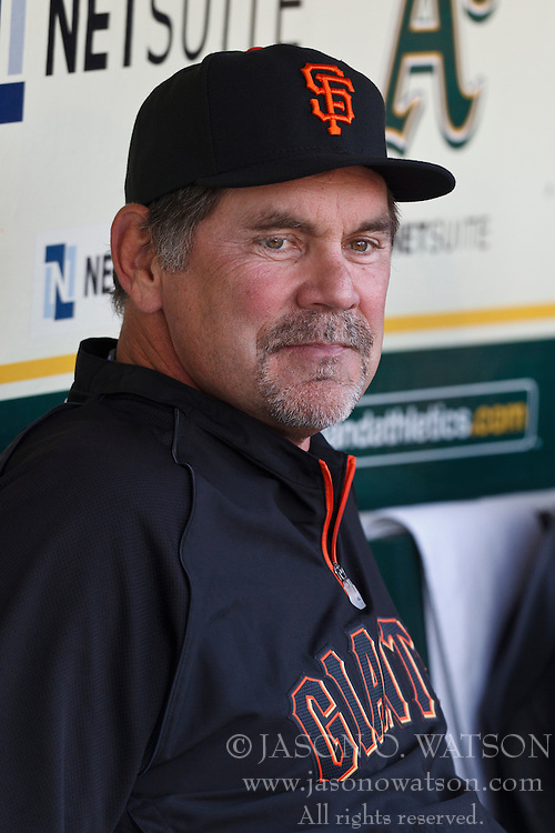 March 29, 2011; Oakland, CA, USA;  San Francisco Giants manager Bruce Bochy (15) sits in the dugout before the game against the Oakland Athletics at Oakland-Alameda County Coliseum.