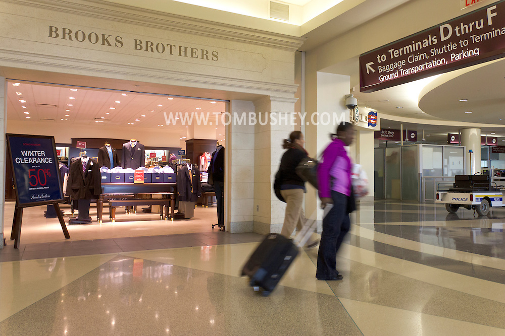 Philadelphia, Pennsylvania - Two women walks past a Brooks Brothers store at Philadelphia International Airport on Jan. 26, 2013.