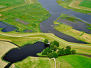 "Nederland, Overijssel, Gemeente Kampen; 21–06-2020; het Reevediep met de Noordwendigedijk en Molenkolk.<br /> Het Reevediep is aangelegd in het kader van het project Ruimte voor de Rivier om bij hoogwater water af te voeren voordat dit het nabij gelegen Kampen bereikt, direct naar het IJsselmeer, de 'bypass Kampen'. Het Reevediepgebied is ook een natuurgebied en vormt een ecologische verbindingszone tussen rivier de IJssel en Drontermeer.<br /> Reevediep, the Noordwendigedijk and scour hole<br /> The Reevediep has been constructed as part of the Room for the River project, and functions to discharge high waters before reaching the nearby Kampen, directly to the IJsselmeer, the ""bypass Kampen"". The Reevediep area is also a nature reserve and forms an ecological connecting zone between the river IJssel and Drontermeer.<br /> <br /> luchtfoto (toeslag op standard tarieven);<br /> aerial photo (additional fee required)<br /> copyright © 2020 foto/photo Siebe Swart"