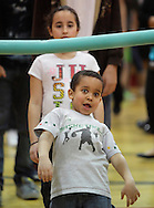 Middletown, New York - A boy goes under the foam bar during a limbo contest at Family Night at the Middletown YMCA on April 2, 2011.
