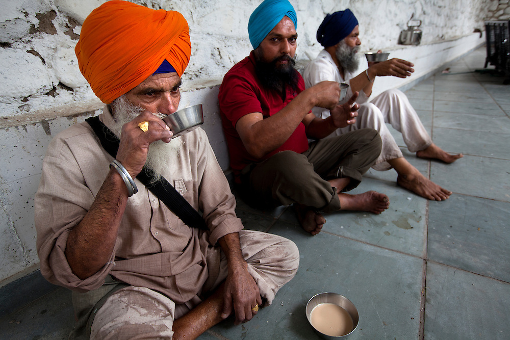 Volunteers in a Sikh kitchen taking a short break.The Sikh kitchen is a part of the Sikh kitchen and  provides ten of thousands of free meals on a daily basis.