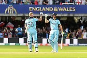 Ben Stokes of England and Jos Buttler of England score 15 from the super over and go to touch gloves during the ICC Cricket World Cup 2019 Final match between New Zealand and England at Lord's Cricket Ground, St John's Wood, United Kingdom on 14 July 2019.