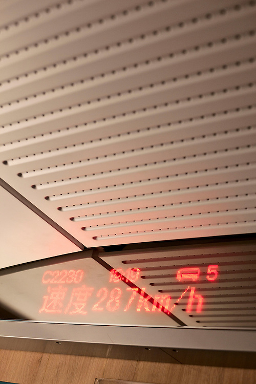 Speedometer inside train carriage on high speed train. China. 2012