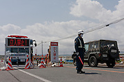 A police roadblock set up on Route 6 in Minami Soma reinforce the 20 kilometre exclusion zone around Fukushima Daiich nuclear power station which was damaged in the march 11th earthquake and tsunami causing radiation leaks and explosions. Minami Soma, Fukushima, Japan. Wednesday May 4th 2011