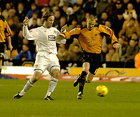 Photo: Leigh Quinnell.<br /> Wolverhampton Wanderers v Leeds United. Coca Cola Championship. 17/12/2005. Wolves' Kenny Miller comes under attack from Leeds' Shaun Derry.