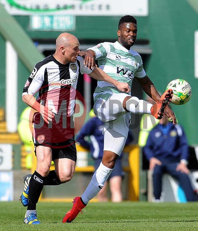 Yeovil Town's Joel Grant is tackled by Gary Jones of Notts County- Photo mandatory by-line: Harry Trump/JMP - Mobile: 07966 386802 - 11/04/15 - SPORT - FOOTBALL - Sky Bet League One - Yeovil Town v Notts County - Huish Park, Yeovil, England.