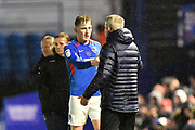 Andy Cannon (14) of Portsmouth shakes hands with Portsmouth manager Kenny Jackett as he is substituted during the EFL Sky Bet League 1 match between Portsmouth and Wycombe Wanderers at Fratton Park, Portsmouth, England on 26 December 2019.