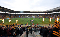 The Wasps team run out onto the pitch for their first ever home match at their new home the Ricoh Arena - Photo mandatory by-line: Patrick Khachfe/JMP - Mobile: 07966 386802 21/12/2014 - SPORT - RUGBY UNION - Coventry - Ricoh Arena - Wasps v London Irish - Aviva Premiership