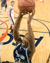 Old Dominion forward Keyon Carter (33) goes up for a dunk against UVA.  The Virginia Cavaliers men's basketball team defeated the Old Dominion Monarchs 80-76 in the second round of the College Basketball Invitational (CBI) at the University of Virginia's John Paul Jones Arena in Charlottesville, VA on March 24, 2008.
