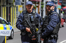 © Licensed to London News Pictures. 04/06/2017. London, UK. Armed policemen patrol the cordons on Borough High Street after the previous night's terrorist attack where a reported three attackers were shot by the police and seven members of the public died after being attacked with knives.  Photo credit : Stephen Chung/LNP