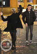 Manchester UK  24.12.2016: Images from Manchesters Gay Village during the Mad Friday celebrations this on the 23 and 24th of December,<br /> <br /> 2 men dance in the street in Manchester  gay village