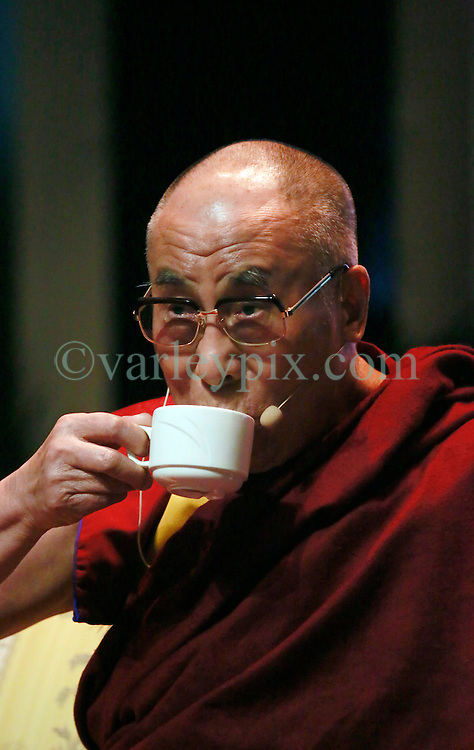 17 May 2013. New Orleans, Louisiana,  USA..His Holiness the 14th Dalai Lama sips tea during a speaking engagement at the Morial Convention Center  in New Orleans for the 'Resiliance - Strength through Compassion and Connection' conference. .Photo; Charlie Varley.