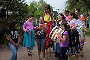 Neusa reading poetry with a group of children on their stilts in the community near the library, Biblioteca Comunitaria do Arquipelago, Porte Alegre, Brazil. <br /> <br /> Cirandar is working in partnership with  C&A and C&A Instituto to implement a network of Community Libraries in eight communities of Porto Alegre.